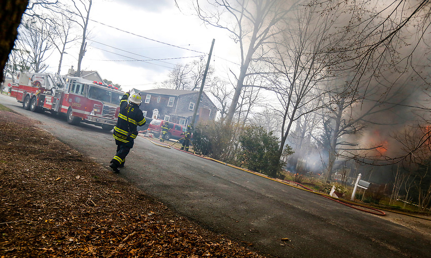 Manasquan fire chief Tom Schofield on scene as firefighters begin to battle a Pearce Avenue structure fire on Easter Sunday, April 1, 2018.