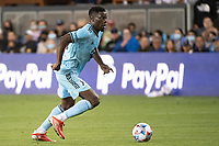 SAN JOSE, CA - AUGUST 17: Bakaye Dibassy #12 of Minnesota United dribbles the ball during a game between San Jose Earthquakes and Minnesota United FC at PayPal Park on August 17, 2021 in San Jose, California.