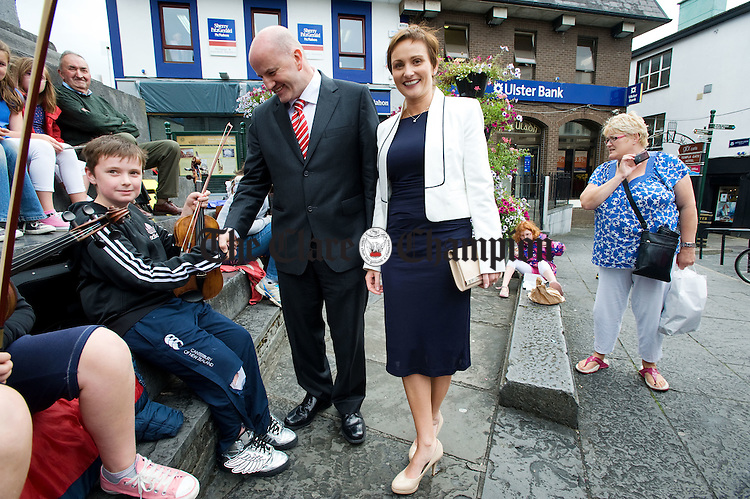 Presidential hopeful Sean Gallagher and his wife Trish meet the people in O Connell Square during his visit to Ennis. Photograph by John  Kelly.