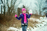 Jessica Adamson,7, play in the fresh snow in the village of Coelbren in the Swansea Valley in South Wales.