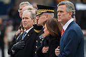Former US President George W Bush and members of the Bush family watch as a joint service honor guard carries the casket of former US President George H.W. Bush out of the  US Capitol in Washington, DC, USA, 05 December 2018. George H.W. Bush, the 41st President of the United States (1989-1993), died at the age of 94 on 30 November 2018 at his home in Texas.<br /> Credit: Shawn Thew / Pool via CNP