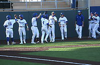 The Rogers squad celebrates after scoring two runs in the fourth inning against Bentonville West Monday April 5, 2021. Rogers won 6-1. Visit nwaonline.com/210405Daily/ and nwadg.com/photos. (NWA Democrat-Gazette/J.T. Wampler)