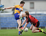 Jamie Malone of  Clare in action against Gerard Mc Govern of Down during their Division 2, Round 2 National League game at Cusack Park. Photograph by John Kelly.
