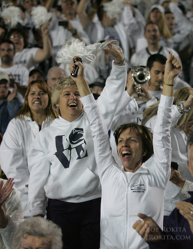 State College, PA - 10/12/2013:  PSU fans celebrate the win in four overtimes.  Penn State defeated Michigan by a score of 43-40 in 4 overtimes on Saturday, October 12, 2013, at Beaver Stadium.<br /> <br /> Photos by Joe Rokita / JoeRokita.com