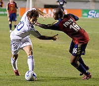 Real Madrid midfielder Juanfran and Real Salt Lake defender Willis Forko battle in the Real Madrid 2-0 win over Real Salt Lake at Rice Eccles Stadium in Salt Lake City, Utah August 12, 2006