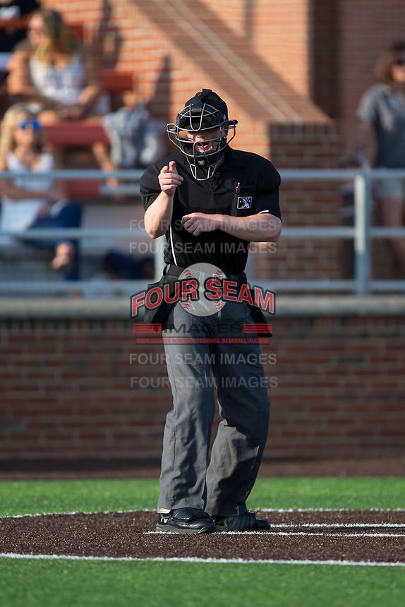 Home plate umpire Thomas Roche makes a strike call during the Carolina League game between the Wilmington Blue Rocks and the Buies Creek Astros at Jim Perry Stadium on April 29, 2017 in Buies Creek, North Carolina.  The Astros defeated the Blue Rocks 3-0.  (Brian Westerholt/Four Seam Images)