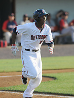 Outfielder Michael Taylor (12) of the Potomac Nationals, a Washington Nationals affiliate, in a game against the Salem Red Sox on June 8, 2012, at Pfitzner Stadium in Woodbridge, Virginia. Taylor is Washington's No. 14 prospect, according to Baseball America. Potomac won, 5-4. (Tom Priddy/Four Seam Images)