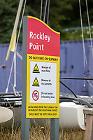 BNPS.co.uk (01202) 558833. <br /> Pic: BNPS<br /> <br /> Pictured: A warning sign by the beach at at Rockley Point in Poole Harbour, Dorset. <br /> <br /> There are fresh calls for a holiday park to increase safety measures at a notorious beach where one swimmer has drowned and almost 20 children rescued this summer. <br /> <br /> In the latest incident a dad and his two young sons were plucked to safety in the nick of time after they were swept away by a rip tide at Rockley Park in Poole Harbour, Dorset.<br /> <br /> It happened a month after hero swimmer Callum Baker-Osborne, 18, drowned while helping to rescue 13 children at the same spot.<br /> <br /> And before that two young girls were saved from drowning by a paddleboarder.