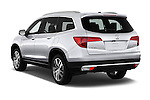 Car pictures of rear three quarter view of 2018 Honda Pilot Touring 5 Door Suv Angular Rear