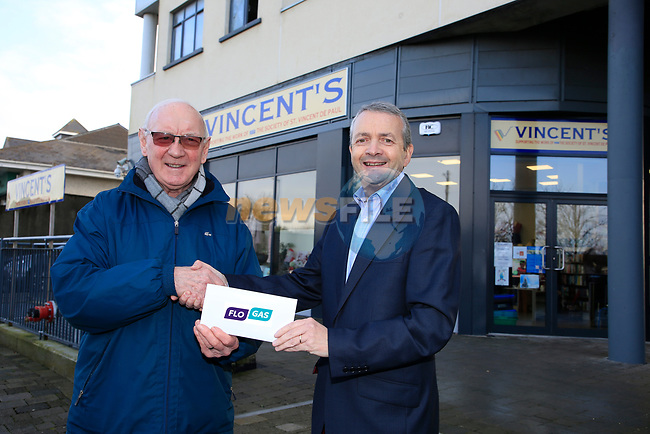 Eoin O'Flynn (R) Marketing manager Flogas Ireland presenting a cheque to Michael Grogan of Vincents outside there new shop premises in Bettystown.<br /> Picture Fran Caffrey   Newsfile