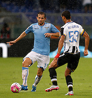 Calcio, Serie A: Lazio vs Udinese. Roma, stadio Olimpico, 13 settembre 2015.<br /> Lazio's Senad Lulic, left, is challenged by Udinese's Ali Adnan during the Italian Serie A football match between Lazio and Udinese at Rome's Olympic stadium, 13 September 2015.<br /> UPDATE IMAGES PRESS/Isabella Bonotto