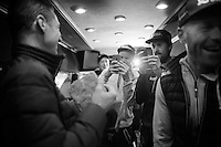 Orica-GreenEDGE teammates joyfully snap the daylights out of the Hell-trophy back on the teambus after Mathew Hayman won the 114th Paris-Roubaix 2016