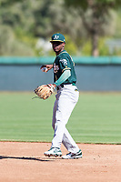 Oakland Athletics second baseman Marcos Brito (5) prepares to throw to first base during an Instructional League game against the Los Angeles Dodgers at Camelback Ranch on September 27, 2018 in Glendale, Arizona. (Zachary Lucy/Four Seam Images)