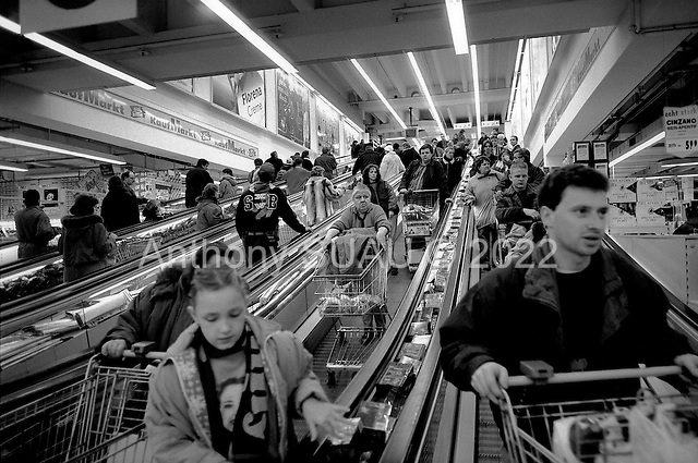 Berlin, Germany  .1998.On the outskirts of Berlin, in a region on the outskirts of Berlin, in a region center stands to cater to the vast population residing here. Kaufpark is the massive food store inside the center. Crowds of Germans fill big carts with all they can..