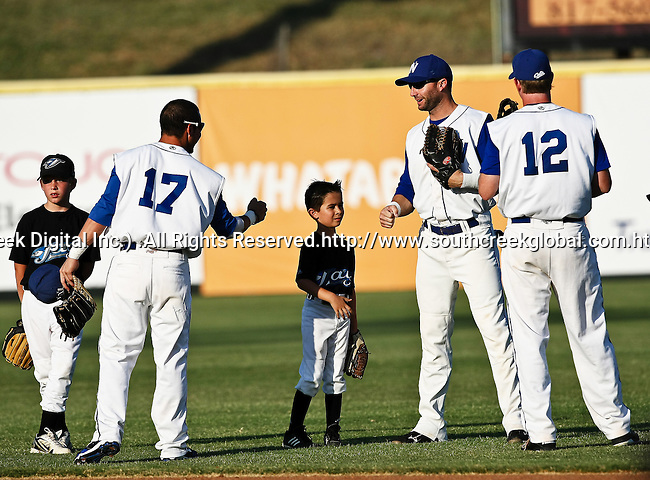 Fort Worth Cats Outfielder Will Calhoun (12), Fort Worth Cats Outfielder Brian Fryer (8) and Fort Worth Cats Outfielder Jeremy Sauceda (17) get ready before the American Association of Independant Professional Baseball game between the Amarillo Sox and the Fort Worth Cats at the historic LaGrave Baseball Field in Fort Worth, Tx. Fort Worth defeats Amarillo 5 to 3.