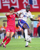Patrick Vieira (4) of France and Eul Yong Lee (13) of Korea Republic. The Korea Republic and France played to a 1-1 tie in their FIFA World Cup Group G match at the Zentralstadion, Leipzig, Germany, June 18, 2006.