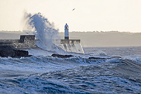 "Pictured: Waves crash into a lighthouse in Porthcawl, Wales, UK. Thursday 07 February 2019<br /> Re: Warnings of strong wind were in place across the whole of Wales starting Wednesday night.<br /> A yellow ""be aware"" weather warning was issued from 10pm on Wednesday until 9am on Thursday.<br /> may be delayed on exposed routes."