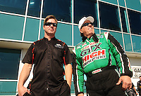 Mar. 13, 2011; Gainesville, FL, USA; NHRA funny car drivers Mike Neff (left) and John Force during the Gatornationals at Gainesville Raceway. Mandatory Credit: Mark J. Rebilas-