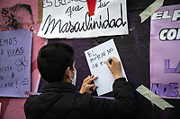 """MADRID, SPAIN – MARCH 08: A boy writing a poster with the message """"the mural is not touched"""" in front of the feminist mural that has been sabotaged the night before 8M in the Ciudad Lineal neighborhood on 8 march in Madrid, Spain. Various demonstrations and protests have been carried out to celebrate and commemorate the international day of working women that is celebrated every year on March 8. (Photo by Joan Amengual / VIEWpress via Getty Images)"""