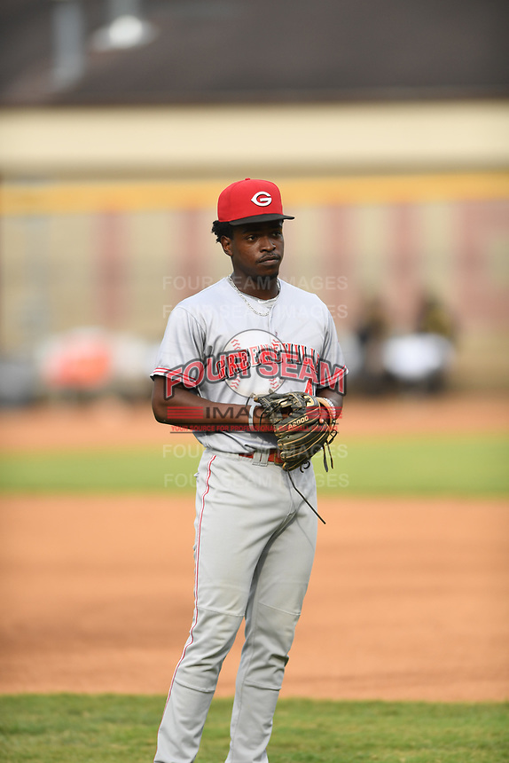 Ivan Johnson (4) of the Greeneville Reds warms up prior to a game against the Bristol Pirates at Boyce Cox Field on July 31, 2019 in Bristol, Virginia. The Pirates defeated the Reds 13-3. (Tracy Proffitt/Four Seam Images)
