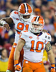 Clemson outside linebacker Ben Boulware (10) and defensive end Austin Bryant (91) celebrate a defensive stop against Alabama in the second half of the 2017 College Football Playoff National Championship in Tampa, Florida on January 9, 2017.  Clemson defeated Alabama 35-31. Photo by Mark Wallheiser/UPI