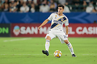 CARSON, CA - SEPTEMBER 15: Joe Corona #14 of the Los Angeles Galaxy looks for an open man during a game between Sporting Kansas City and Los Angeles Galaxy at Dignity Health Sports Complex on September 15, 2019 in Carson, California.