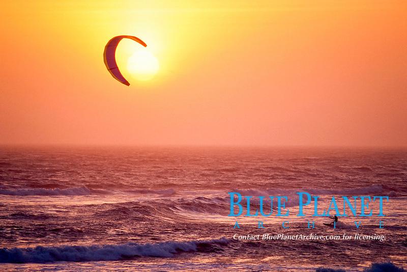 man kiteboarding at sunset, Scott's Creek, California, USA, East Pacific Ocean