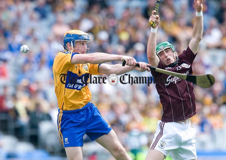 Seadna Morey battles for posession with Galway's Gerard O' Donoghue. Photograph by Declan Monaghan