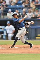 Columbia Fireflies shortstop Milton Ramos (7) swings at a pitch during a game against the Asheville Tourists at McCormick Field on June 17, 2016 in Asheville, North Carolina. The Tourists defeated the Fireflies 6-2. (Tony Farlow/Four Seam Images)