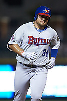 Rowdy Tellez (34) of the Buffalo Bison rounds the bases after hitting a home run against the Charlotte Knights at BB&T BallPark on August 14, 2018 in Charlotte, North Carolina. The Bison defeated the Knights 14-5.  (Brian Westerholt/Four Seam Images)