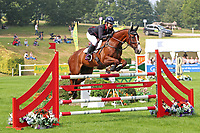 5th September 2021; Bicton Park, East Budleigh Salterton, Budleigh Salterton, United Kingdom: Bicton CCI 5* Equestrian Event; Gemma Tattersall riding Chilli Knight clears one of the final fences on her way to winning the Bicton 5*