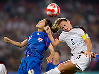 USWNT captain (3) Christie Rampone goes up for a header against Japanese captain (10) Homare Sawa while playing at Worker's Stadium.  The USWNT defeated Japan, 4-2, during the semi-finals of the Beijing 2008 Olympics in Beijing, China.