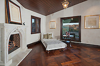 Stock photo of room with daybed by fireplace