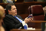 Nevada Senate Minority Leader Michael Roberson, R-Las Vegas, works on the Senate floor during the opening day of the 77th Legislative Session in Carson City, Nev. on Monday, Feb. 4, 2013. .Photo by Cathleen Allison