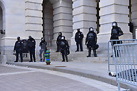 Washington, DC - January 6, 2021: U.S. Capitol Police protect an entrance of the U.S. Capitol as thousands of people in support of President Donald Trump surround the U.S. Capitol building January 6, 2021 as Congress was in session to accept the electors of the November 3 presidential election.  (Photo by Don Baxter/Media Images International)