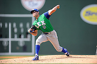 Starting pitcher Cody Reed (9) of the Lexington Legends delivers a pitch in his Class A debut against the Greenville Drive on Sunday, April 27, 2014, at Fluor Field at the West End in Greenville, South Carolina. Reed was a second-round pick of the Kansas City Royals in the 2013 First-Year Player Draft. Greenville won, 21-6, and Reed took the loss. (Tom Priddy/Four Seam Images)