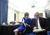 United States Senator Susan Collins (Republican of Maine) speaks to an aide at the US Senate Small Business and Entrepreneurship Hearings to examine implementation of Title I of the CARES Act on Capitol Hill in Washington, DC on Wednesday, June 10, 2020. <br /> Credit: Kevin Dietsch / Pool via CNP/AdMedia