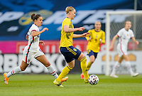 SOLNA, SWEDEN - APRIL 10: Carli Lloyd #10 of the United States chases down Fischer #5 of Sweden during a game between Sweden and USWNT at Friends Arena on April 10, 2021 in Solna, Sweden.