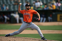 OAKLAND, CA - SEPTEMBER 25:  Kendall Graveman #31 of the Houston Astros pitches against the Oakland Athletics during the game at the Oakland Coliseum on Saturday, September 25, 2021 in Oakland, California. (Photo by Brad Mangin)
