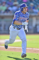 Tennessee Smokies catcher Miguel Montero (17) runs to first during a game against the Birmingham Barons on August 2, 2015 in Kodak, Tennessee. The Smokies defeated the Barons 5-2. (Tony Farlow/Four Seam Images)