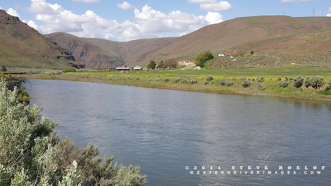 Murtha Ranch on the John Day River, Oregon. Note the wind tubines on the ridge above.