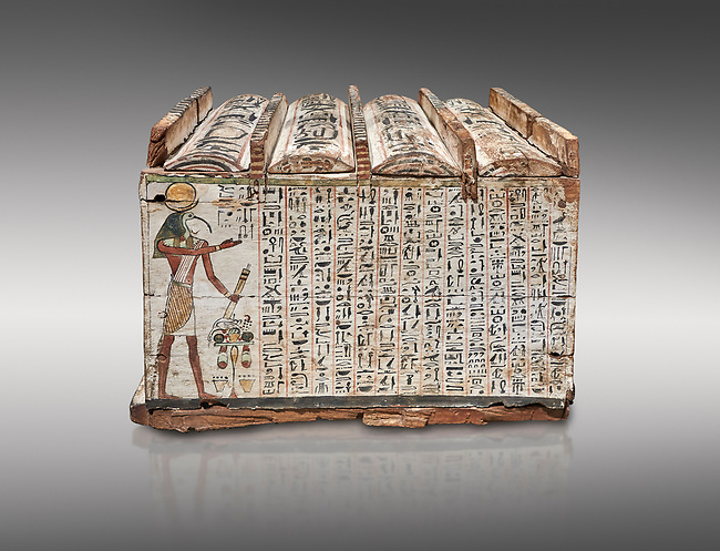 Ancient Egyptian shabti box, wood, Intermediate Period, 21st-22nd Dynasty (1076-746 BC), Thebes, Egyptian Museum, Turin. Grey background.<br /> <br /> Floor 1 room 10 of Museum - Among the 401 shabti found in this tomb were 36 overseerers, one for every 10 servants. These were maent to serve the deceased in the afterlife<br /> <br /> Essential items of funerary equipment from the New Kingdom on, shabti figures, of which there could be from 1 to over 400 examples in a single tomb, were meant to substitute for the deceased whenever he or she was called upon to perform manual labor in the afterlife. the shabti box is a decorated wooden box to hold the figures