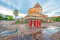 Monks at Wat Chedi Luang Buddhist Monastery in Chiang Mai, Thailand.