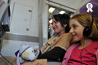 Mother and daughter in airplane (Licence this image exclusively with Getty: http://www.gettyimages.com/detail/84430568 )