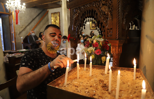 Palestinian Christians attend Orthodox Easter serivece at the church of Saint Porphyrius, in Gaza city, on May 02, 2021. Easter, or Resurrection Sunday, is a Christian festival and cultural holiday commemorating the resurrection of Jesus from the dead, described in the New Testament as having occurred on the third day after his burial following his crucifixion by the Romans at Calvary c. 30 AD It is the culmination of the Passion of Jesus, preceded by Lent (or Great Lent), a 40-day period of fasting, prayer, and penance. Photo by Mahmoud Ajjour