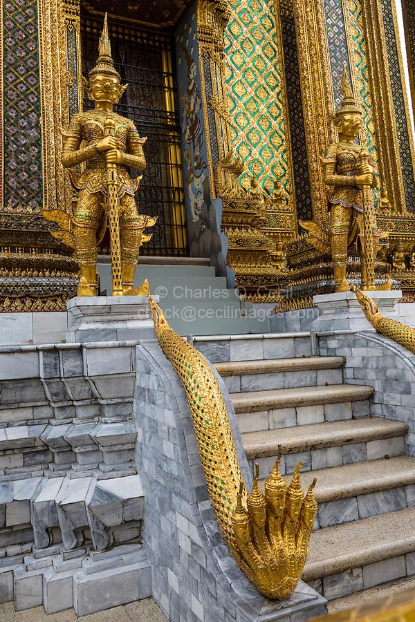 Bangkok, Thailand.  Demons (Yakshas)  and Five-headed Naga (Snake) Guarding Entrance to the Phra Mondop, Royal Grand Palace Compound.