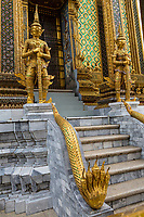 Bangkok, Thailand.  Demons (Yakshas)  and Five-headed Naga (Snake) Guarding Entrance to the Phra Mondop, Royal Grand Palace Compound.