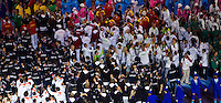 12 AUG 2012 - LONDON, GBR - The athletes fill the areas around the Union flag design stage during the London 2012 Olympic Games Closing Ceremony in the Olympic Stadium in the Olympic Park, Stratford, London, Great Britain (PHOTO (C) 2012 NIGEL FARROW)
