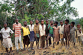 Chambeshi River, Zambia. Group of Bemba village children wearing tatty, stained clothes in rural setting. Northern Province.