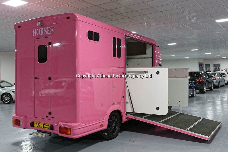 """Pictured: The pink Fiat Ducato horsebox once owned by tv personality Katie Price.<br /> Re: A pink horsebox owned by Katie Price is up for grabs at auction after failing to sell on eBay.<br /> The 2012 registered Fiat Ducato is instead listed on the John Pye online auction site and is now at the company's depot in Port Talbot, south Wales.<br /> The vehicle has only covered 7,000 miles, with additional features EQUI-TREK SUPER SONIC HORSE BOX CARRIER.<br /> Previously owned by Model/TV celebrity Katie Price<br /> 3.5 t finished paint work in Pink by Kahn.<br /> 2 Horse carrier.<br /> Cream Leather interior.<br /> Tachograph.<br /> Aircon.<br /> Grooms Locker.<br /> Extra height partition.<br /> Skylight Roof Vent.<br /> Internal Lighting.<br /> Tinted windows.<br /> Tie Rings on external.<br /> Internal and rear reversing cameras.<br /> wireless camera system with 7"""" screen"""